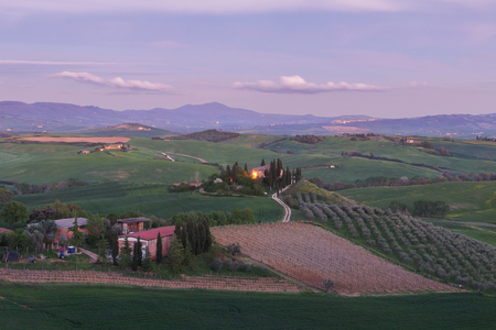 agriturismo: Farmhouse, green hills,cypress trees in Tuscany at sunset in Italy,Europe