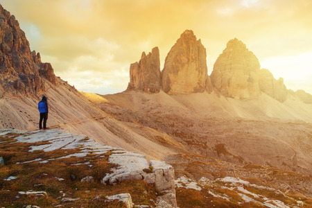 Tre Cime di Lavaredo in beautiful surroundings at lonely man  in the Dolomites at sunset in Italy, Europe (Drei Zinnen)