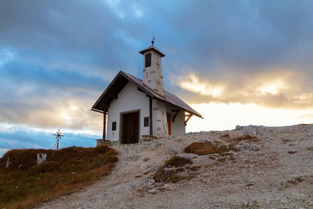 Tre Cime di Lavaredo in beautiful surroundings and one little chapel in the Dolomites at sunset in Italy, Europe (Drei Zinnen)