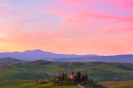 the arable land: Typical Tuscany landscape springtime at sunset  in Italy,Europe Stock Photo