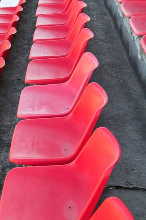 gradas estadio: Football stadium bleachers red chairs