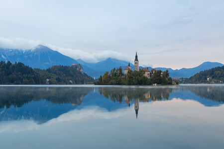 Lake Bled and the island with the church at autumn color at sunrise in Slovenia