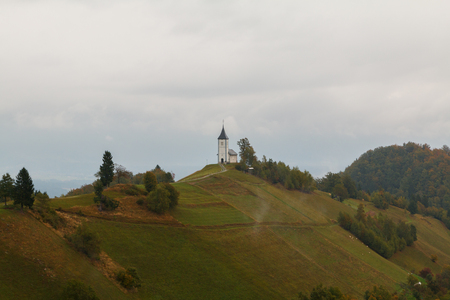 karavanke: Jamnik church on a hillside in autumn at sunset in Slovenia, Europe Stock Photo