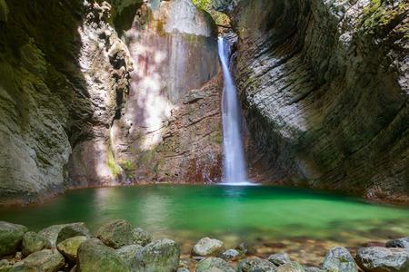 cavern: Kozjak waterfalls to the beautiful cave of Triglav National Park in Slovenia Stock Photo