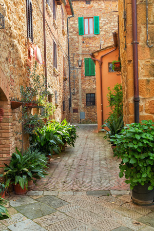pienza: Beautiful narrow alley with traditional historic houses at Pienza city in Tuscany