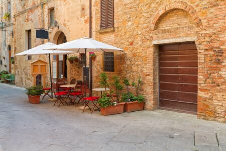 Beautiful medieval town of narrow streets and charming porch in Pienza,Italy Stock Photo