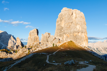 Cinque Torri mountain, beautiful autumn colors in Dolomites mountain on the background Tofana peak in valley Cortina D'Ampezzo city at Italy, Europe