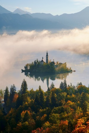 Beautiful foggy sunrise the Bled lake on autumn in Slovenia,Europe Foto de archivo