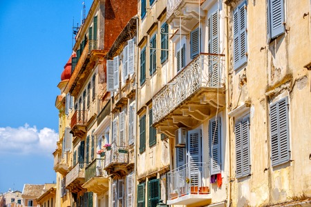 Beautiful island of Corfu and old houses in the charming little streets in Greece ( Kerkyra ) Imagens