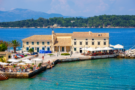 Beautiful island of Corfu and old houses in the foreground of the wonderful blue sea in Greece ( Kerkyra )