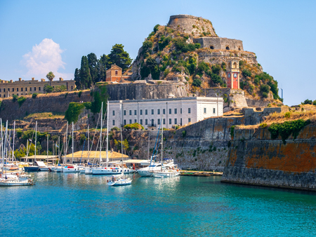 Beautiful island of Corfu and old fortress in the foreground of the wonderful blue sea in Greece ( Kerkyra )