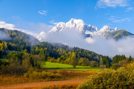 Beautiful autumn colors at the lake Zelenci in the background the Martuljek mountain near the  Kranjska  Gora at Triglav national park  in Slovenia,Europe