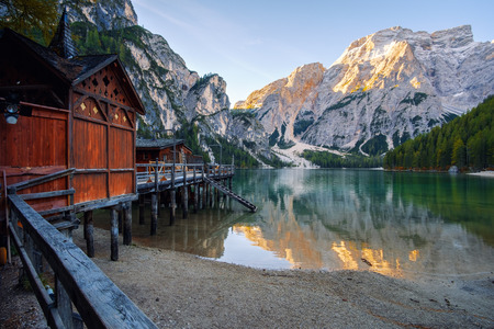 Beautiful Braies lake and house in the background of Seekofel mountain in Dolomites,Italy ( Pragser Wildsee )