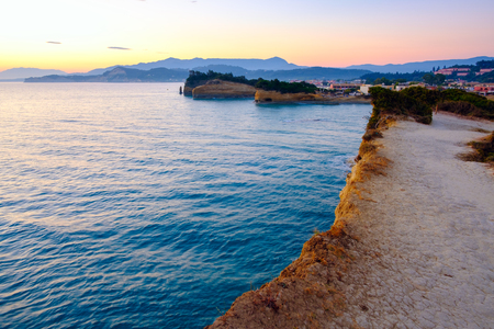 Famous Canal dAmour beach with beautiful rocky coastline in amazing blue Ionian Sea at sunrise in Sidari holiday village on Corfu island in Greece