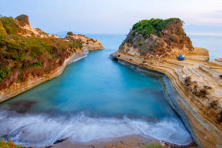 Famous Canal d'Amour beach with beautiful rocky coastline in amazing blue Ionian Sea at sunrise in Sidari holiday village on Corfu island in Greece,Europe