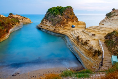 Famous Canal dAmour beach with beautiful rocky coastline in amazing blue Ionian Sea at sunrise in Sidari holiday village on Corfu island in Greece,Europe