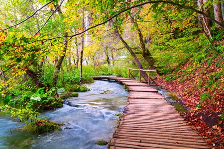 Famous Plitvice lakes with beautiful autumn colors and magnificent views of the waterfalls in Croatia, Plitvice national park Stock Photo