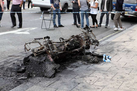 turmoil: City of Westminster, London, England - August 6, 2011: Burned-out motorcycle on the first day of riots in London