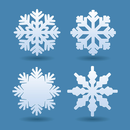 copo de nieve: Set of white snowflakes. Vector Icons. Vectores