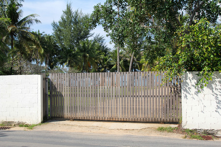 Wooden gate in Thailand. Property and Garden.