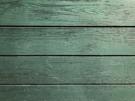 Texture of green wooden bords. Wall and background.
