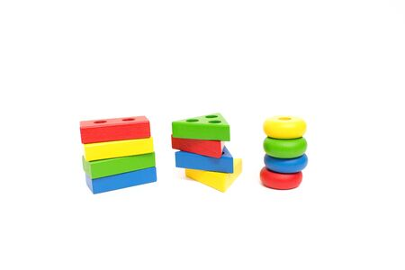toy wooden blocks, multicolor building construction bricks over white background. Early education concept