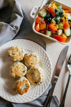 Chicken or turkey cutlets with vegetable salad from above. Healthy home food for diet.