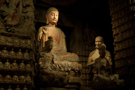 Thousand-year old Buddha from the Grottoes of Zhongshan Mountain, Shaanxi Province, China photo