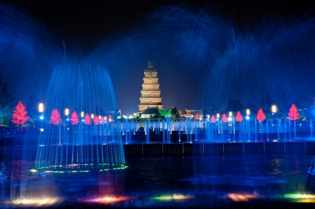 Illuminated water show at 1300-year-old Big Wild Goose Pagoda in Xian, Shaanxi province, China photo