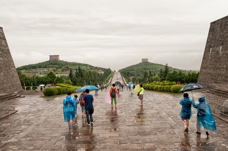 empress: Shaanxi province, China - July 2, 2012: The yet unexcavated tombs of Tang dynasty Emperor Gaozong and his concubine and successor empress Wu Zetian attract crowds of tourist even on rainy days.