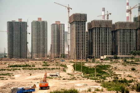 Xian, China - June 30, 2012: China evolves rapidly as illustrated by this extensive housing project in Xian. Chinese economy is one of the fastest growing in the world and currently only second to USA in size. Редакционное