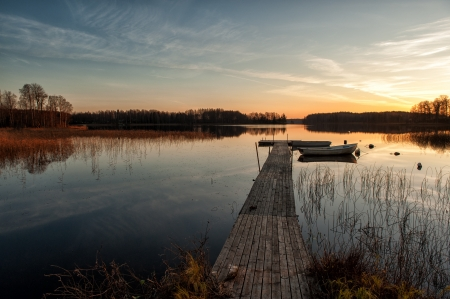 Autumn sunset at a lake in Ostergotland, Sweden Stock Photo