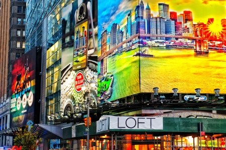 New York City, NY, USA � May 5, 2011: Illuminated facades by night at Times Square in New York City.