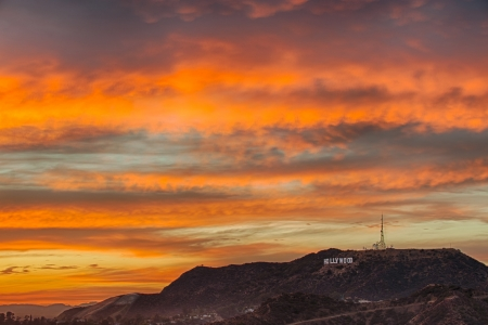 Los Angeles, USA – September 23, 2012: Colorful sky over Hollywood Hills and the Hollywood sign at dusk. The Hollywood sign remains an iconic symbol for Los Angeles.
