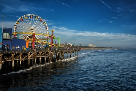docks: Los Angeles, USA - September 22, 2012: Santa Monica Pier is a more than hundred-year-old historic landmark that contains Pacific Park, a famous amusement park.