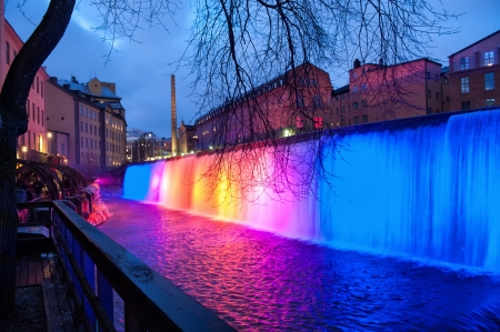 NORRKOPING, SWEDEN - DECEMBER 31: The waterfall in the famous industrial landscape on December 31, 2008 in Norrkoping. The industrial landscape is illuminated during Christmas time and New Years Eve. Редакционное