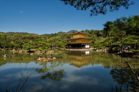 Kyoto, Japan - April 8, 2013: Kinkaku-ji or the Golden Pavilion Temple on Kyoto on a sunny spring day.  The Golden Pavilion is one of 17 UNESCO World Heritage sites in Kyoto.