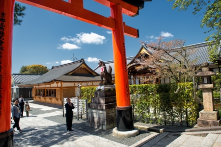 reverence: Kyoto, Japan - April 8, 2013: Japanese man pays respect as he enters a Torii gate at Fushimi Inari Shrine in Kyoto. Fushimi Inari Shrine is one of 17 UNESCO World Heritage sites in Kyoto.