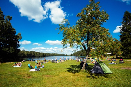 Norrkoping, Sweden - August 4, 2013  Summer in Sweden - people enjoying a sunny day by a lake