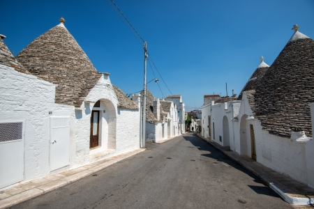 Alberobello, Italy - July 13, 2013  Trulli houses in Alberobello, Puglia, Italy  The trulli of Alberobello is a UNESCO World Heritage site