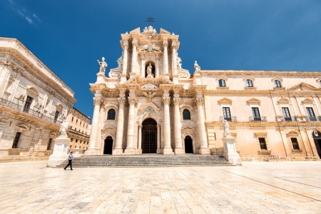 Syracuse, Sicily, Italy - July 16, 2013  Duomo di Siracusa at Piazza Duomo  The cathedral was begun in the 7th century and incorporates columns of an old Greek temple in the wall  The facade in Baroque style was built in the early 18th century  Editorial