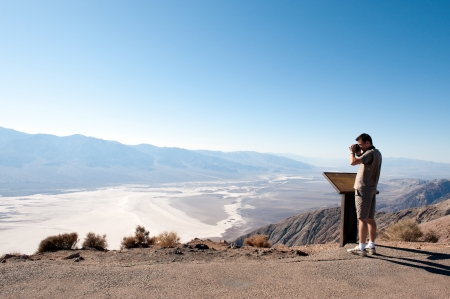 Death Valley, CA, USA - September 7,2008  A tourist takes a view at Badwater basin from dante s view in Death Valley  Badwater basin is the lowest point in USA at an elevation of 86 meters below sea level