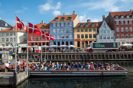 Copenhagen, Denmark – August 21, 2013  Nyhavn in Copenhagen is a 17th-century waterfront, canal and entertainment district and one of the most popular tourist attractions in Copenhagen