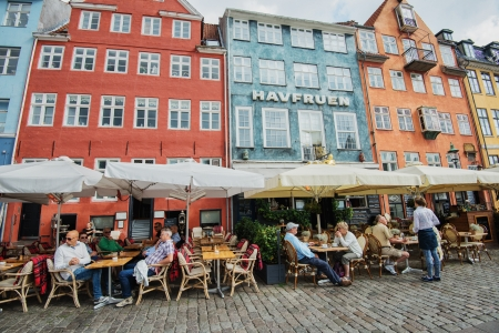 Copenhagen, Denmark - August 21, 2013  Tourists enjoy lunch in Nyhavn, Copenhagen  Nyhavn is a 17th-century waterfront, canal and entertainment district and a major tourist attraction in Copenhagen