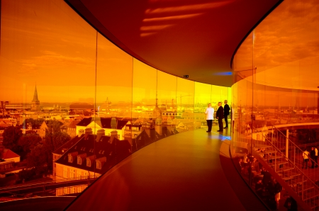 Aarhus, Denmark – August 23, 2013  Three men admire a panoramic view of Aarhus from the roof of Aros Art Museum  The museum is the second most visited in Denmark