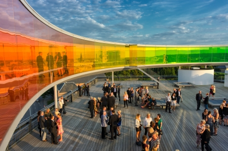 mingle: Aarhus, Denmark � August 23, 2013  Conference participants mingle below the rainbow panorama on the roof of Aros Art Museum  The museum is the second most visited in Denmark  Editorial