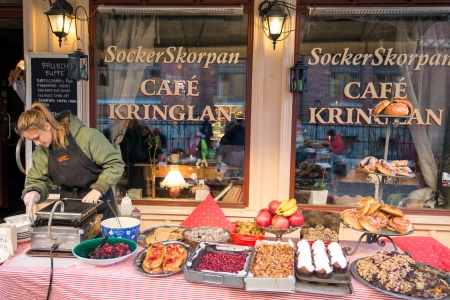 Gothenburg, Sweden - November 17, 2013  A coffee shop serves coffee outdoors in Haga, Gothenburg  Haga is a historic and fashionable residential area that is very popular among tourists