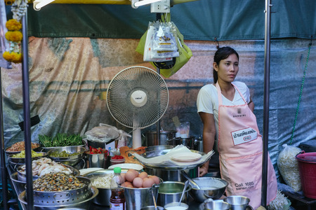 night market: Hua Hin, Thailand � February 27, 2013  Thai woman running a street food stall at the night market in Hua Hin  The famous night market in Hua Hin is a major tourist attraction  Editorial