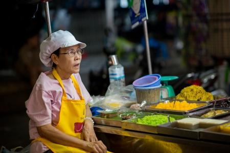 night market: Hua Hin, Thailand � January 17, 2013  Thai woman sells street food at the night market in Hua Hin  The famous night market in Hua Hin is a major tourist attraction  Editorial