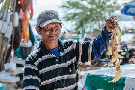 hin hua: Hua Hin, Thailand � January 15, 2013  Proud Thai fisherman displays his catch  in Khao Kalok south of Hua Hin  Hua Hin is a major tourist destination renown for it s seafood
